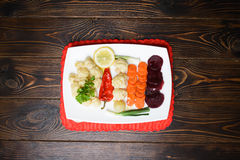 Vegetables Plate on Red Napkin Stock Photos