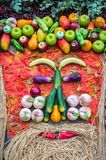 Vegetables portrait. Fresh organic Vegetables on Wooden table wi. Th autumn leaves. Healthy Vegetarian food Royalty Free Stock Image