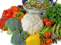 Vegetables and pot of soup.Isolated. Royalty Free Stock Images