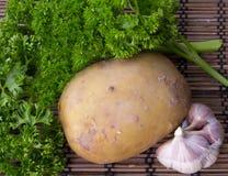 Vegetables. Potatoes, parsley and garlic closeup Royalty Free Stock Photo