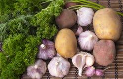 Vegetables. Potatoes, parsley and garlic closeup Stock Photos