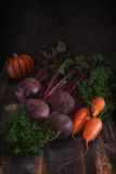 Vegetables and pumpkin against the background of old boards Stock Image