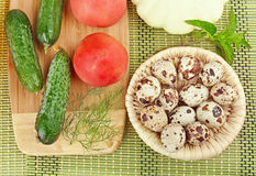 Vegetables and quail eggs Royalty Free Stock Images