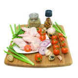 Vegetables, quail eggs and raw chicken wings on a white backgrou Stock Photo