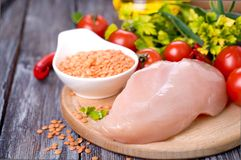Vegetables, raw chicken and fresh lentils Royalty Free Stock Photos