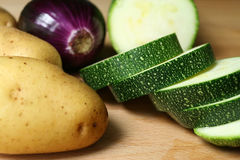 Vegetables ready to use. Fresh raw vegetables from organic farm. Potatoes, zucchini and onion Royalty Free Stock Photos