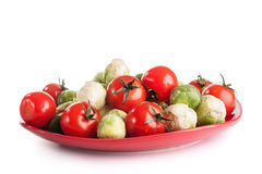 Vegetables on red plate Royalty Free Stock Photo