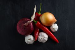 Vegetables red and yellow onions with red pepper and garlic. View top Stock Photo