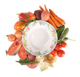 Vegetables round a plate. Vegetables lie round a plate Stock Photos