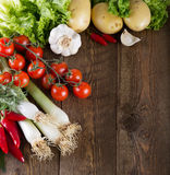 Vegetables on a rustic wooden table stock photography