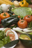 Vegetables and salad. Fresh vegetables and salad on a table stock photos