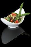 Vegetables salad. On black background Stock Photos