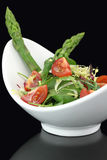 Vegetables salad. With spinach, asparagus and cherry tomatoes Stock Photography