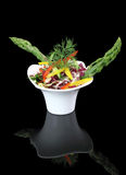 Vegetables salad with asparagus. On a bowl Royalty Free Stock Photo