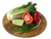 Vegetables for salad on a board. A white background royalty free stock images