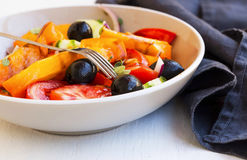 Vegetables salad closeup with tomatoes, olives,onion , cucumber Royalty Free Stock Photos