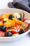 Vegetables salad closeup with tomatoes, olives,onion , cucumber Royalty Free Stock Photo