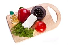 Vegetables for salad on the cutting board Stock Images