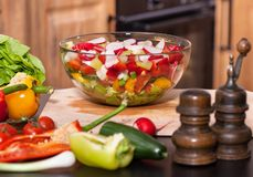 Vegetables salad on the cutting board in the kitchen Stock Images