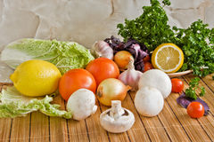 Vegetables, salad, food. On a table vegetables for salad preparation lie Stock Photography