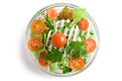 Vegetables salad in a glass salad bowl. Over white background stock photography