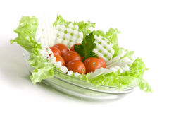 Vegetables salad in a glass salad bowl. Over white background stock image