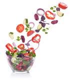Vegetables for a salad of lettuce falling. Stock Images