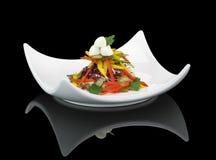 Vegetables salad with mozzarella. On black background Royalty Free Stock Image