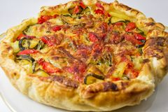 Vegetables salad pie. quiche with zucchini, peppers, potatoes and puff pastry. for vegerarian cousine concept Stock Images