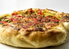 Vegetables salad pie. quiche with zucchini, peppers, potatoes and puff pastry. for vegerarian cousine concept Royalty Free Stock Image