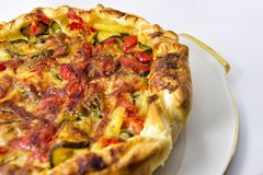 Vegetables salad pie. quiche with zucchini, peppers, potatoes and puff pastry. for vegerarian cousine concept Stock Photos