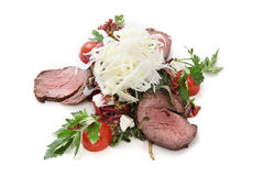 Vegetables salad with roast beef. Vegetables: cherry tomatoes, greens, parsley, feta cheese with roast beef on a white background stock photos