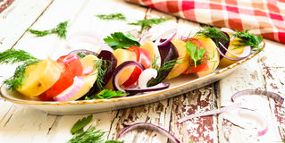 Vegetables salad on the table. Simple vegetables dish on the wooden table Stock Photos