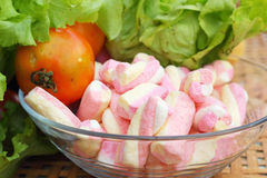 Vegetables salad, tomato and pink marshmallows. Stock Photography