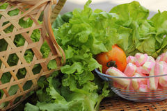 Vegetables salad, tomato and pink marshmallows. Royalty Free Stock Images