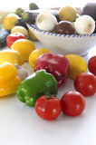 Vegetables for a Salad. You can see in a white table various vegetables: lemons, tomatoes, onions, garlic, zucchini, peppers, cucumbers, leeks. Some are in a Stock Photo