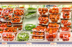 Vegetables for sale. Closeup inside an Italian supermarket with large quantities of tomatoes, a classic food for the Mediterranean cuisine Stock Photography
