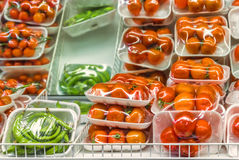 Vegetables for sale. Closeup inside an Italian supermarket with large quantities of tomatoes, a classic food for the Mediterranean cuisine Stock Image