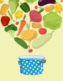 Vegetables in saucepan. Boil vegetable soup. Vegetarian food. Co Stock Photos