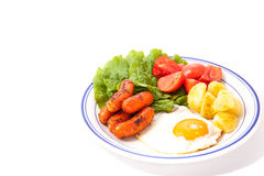 Vegetables and sausage and fried egg Royalty Free Stock Photography
