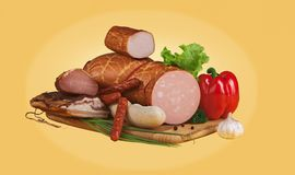 Vegetables and sausages on a wooden board Royalty Free Stock Photography