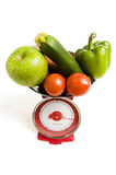 Vegetables on scale Royalty Free Stock Image