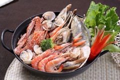 Vegetables seafood chaffy dish Stock Images