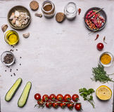 Vegetables  seasonings, frame laid out on a white wooden background  top view Royalty Free Stock Photos