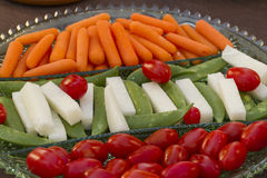 Vegetables served as horderves before dinner. Plated carrots, tomatoes, jimaca and snap peas as a before dinner snack Stock Photo