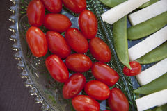 Vegetables served as horderves before dinner. Plated carrots, tomatoes, jimaca and snap peas as a before dinner snack Royalty Free Stock Photo