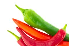 Vegetables sharp long chili peppers red green contrast on a white background stock image