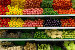 Vegetables on shelf in supermarket. Different egetables on shelf in supermarket Stock Photo