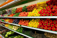 Vegetables on shelf in supermarket. Different egetables on shelf in supermarket Stock Image