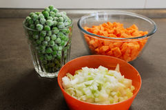 Vegetables for Shepherd`s pie making. Frozen peas, diced carrots and chopped onion royalty free stock photos